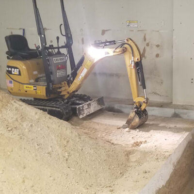interior trenching for drainage systems - waterproofing applications in basements - concrete slab construction Rhode Island MA